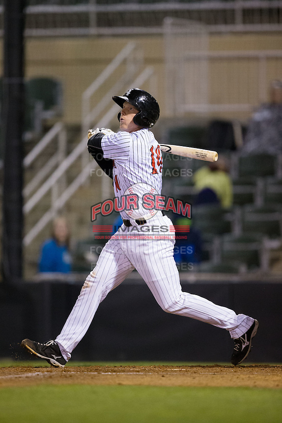 Casey Schroeder (10) of the Kannapolis Intimidators follows through on his swing against the Hickory Crawdads at Kannapolis Intimidators Stadium on April 9, 2016 in Kannapolis, North Carolina.  The Crawdads defeated the Intimidators 6-1 in 10 innings.  (Brian Westerholt/Four Seam Images)