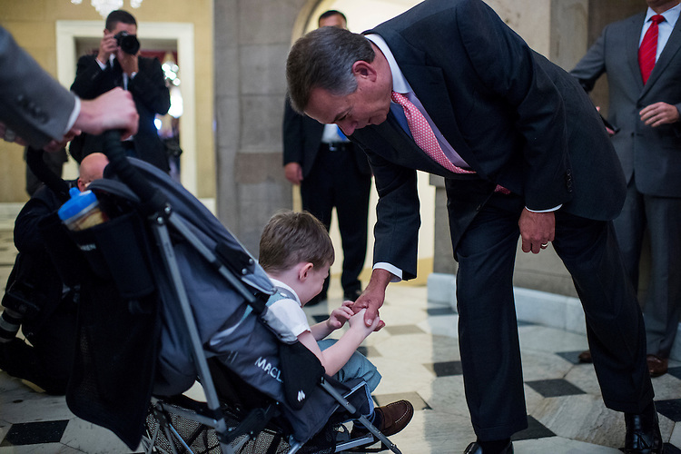 UNITED STATES - OCTOBER 10: Speaker of the House John Boehner, R-Ohio, shakes hands with John Griffin, age 3, son of Rep. Tim Griffin, R-Ark., as he walks back to his office after a vote on the House floor in the Capitol on Thursday, Oct. 10, 2013. (Photo By Bill Clark/CQ Roll Call)