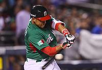 Xorge Carrillo de Mexico conecta la pelota en su turno al bat , durante el partido Mexico vs Venezuela, World Baseball Classic en estadio Charros de Jalisco en Guadalajara, Mexico. Marzo 12, 2017. (Photo: AP/Luis Gutierrez)