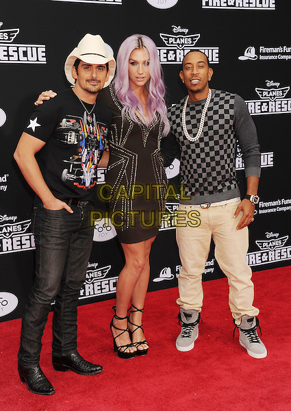 HOLLYWOOD, CA- JULY 15: (L-R) Singers Brad Paisley, Kesha and actor/rapper Ludacris arrive at the Los Angeles premiere of Disney's 'Planes: Fire &amp; Rescue' at the El Capitan Theatre on July 15, 2014 in Hollywood, California.<br /> CAP/ROT/TM<br /> &copy;Tony Michaels/Roth Stock/Capital Pictures