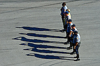 19-20 February, 2016, Daytona Beach, Florida USA<br /> Local police officers stand at attention for the Nation Anthem.<br /> ©2016, F. Peirce Williams