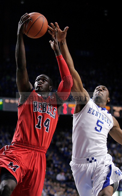 University of Kentucky senior guard Ramon Harris tries to block a layup by Ole Miss guard Eniel Polynice in UK's 85-75 win on Tuesday, Feb. 2, 2010 in Rupp Arena...Photo by Ed Matthews | Staff