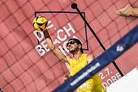 26th June 2020, Dusseldorf, Germany; The German Beach Volleyball League; Felix Gluecklederer fires over the net