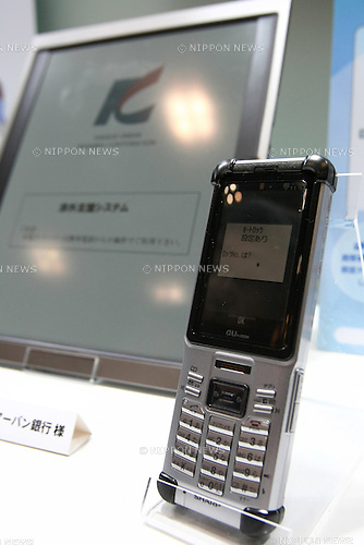 Apr 16, 2010 - Tokyo, Japan - A mobile phone and a Bridgestone electronic paper display device featuring a 'Quick Response Liquid Powder Display' (QR-LPD) are on display at Finetech Japan 2010 trade show in Tokyo on April 16, 2010.