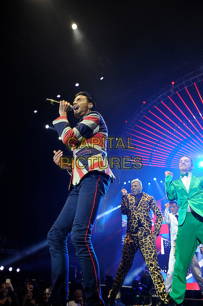 Rylan Clark.Performing on the X Factor Tour, o2 Arena, London, England. .8th February 2013.on stage in concert live gig performance performing music full length  black  suit jacket red white blue union jack jacket trousers dancing backup dancers green leopard print  singing side profile .CAP/MAR .© Martin Harris/Capital Pictures.