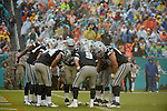MIAMI GARDENS, FL - NOVEMBER 22:  Tony Romo #9  of the Dallas Cowboys in the huddle on his first possession during their NFL game against the Miami Dolphins on November 22, 2015 at Sun Life Stadium in Miami Gardens, Florida. (Photo by Donald Miralle)