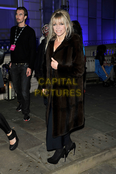 JO WOOD.The launch of Vivienne Westwood's Get A Life Palladium jewellery launch party, London, England. .February 18th, 2011.full length black brown fur coat   LFW.CAP/MAR.© Martin Harris/Capital Pictures.