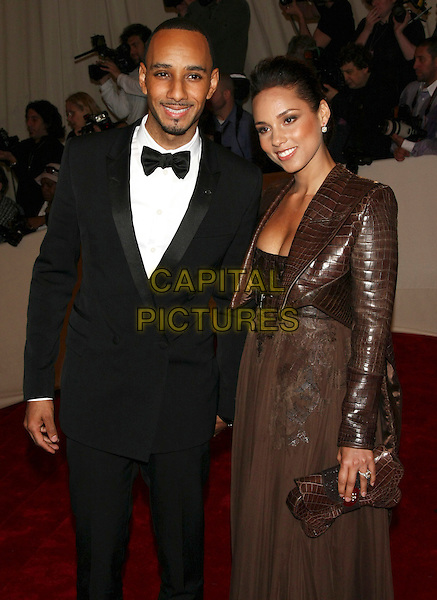 "SWIZZ BEATZ (Kasseem Daoud Dean)  & ALICIA KEYS .attending the Metropolitan Museum of Art's Costume Institute Gala ""Alexander McQueen: Savage Beauty"" held at the Metropolitan Museum of Art, New York, NY, USA, May 2nd 2011..half length couple husband wife black tuxedo tux bow tie  leather brown croc jacket  dress clutch bag .CAP/LNC.©TOM/LNC/Capital Pictures."