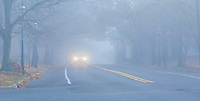 Car driving through a Foggy Neighborhood and country road