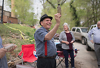 """NWA Democrat-Gazette/CHARLIE KAIJO Crescent Hotel tour manager Keith Scales holds up a jar pulled from an excavation site, Thursday, April 11, 2019 behind the Crescent Hotel in Eureka Springs. <br /><br />An old trash dump has been discovered behind the Crescent Hotel in Eureka Springs. It contains hundreds of bottles dating from the late 1930s, when the building was a """"cancer"""" hospital run by a quack doctor named Norman Baker. A team of archeologists from the University of Arkansas studied the site and revealed what they found."""