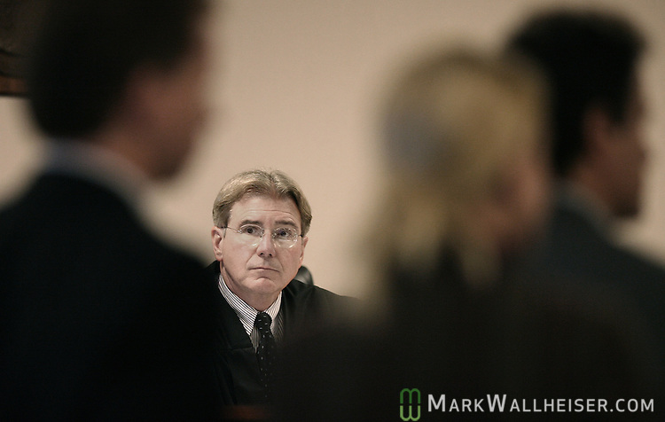 Judge Michael Overstreet, center, looks at prosecutors during the arraignment for the eight defendants in the Martin Lee Anderson case at the Bay County Courthouse in Panama City Thursday Jan. 18, 2007.  (Mark Wallheiser/TallahasseeStock.com)