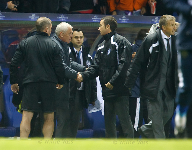 Walter Smith shakes hands with the Unirea staff as Dan Petrescu heads off to celebrate