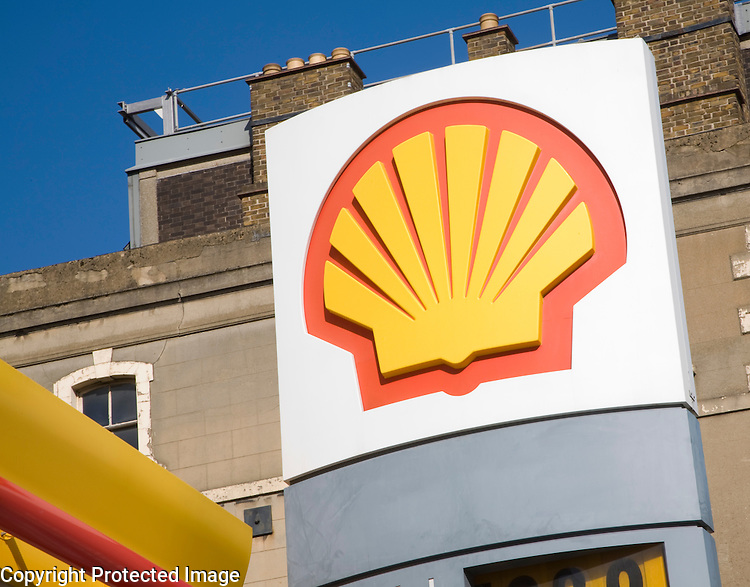 Close up of logo of Shell oil company above petrol station in London, UK