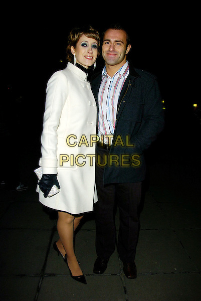 "CONNIE FISHER & PARTNER.At the ""Dreamgirls"" Film Premiere After Party, Hayward Gallery, London, England, January 21st 2007..full length white cream coat.CAP/CAN.©Can Nguyen/Capital Pictures"