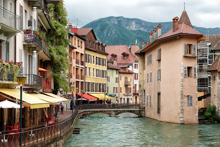 The riverfront town of Annecy is a picturesque blend of emerald green lake water, quiet outdoor cafes, and quaint buildings.