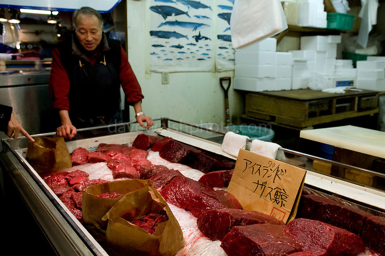 "Whale Meat Shop at Tsukiji Fish Market, Tokyo. The meat on display includes endangered fin whale meat, recently controversially imported from Iceland... the cardboard sign reads ""fin whale, Iceland"". Tsukiji fish market is the biggest wholesale fish and seafood market in the world."