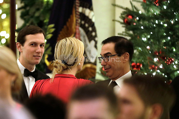 United States Secretary of the Treasury Steven T. Mnunchin (R) talks to First Daughter and Advisor to the President Ivanka Trump and her husband Senior Advisor Jared Kushner at the Congressional Ball at White House in Washington on December 15, 2018.<br /> Credit: Yuri Gripas / Pool via CNP / MediaPunch