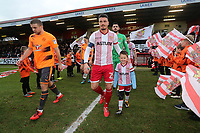 The teams take to the field during Stevenage vs Reading, Emirates FA Cup Football at the Lamex Stadium on 6th January 2018