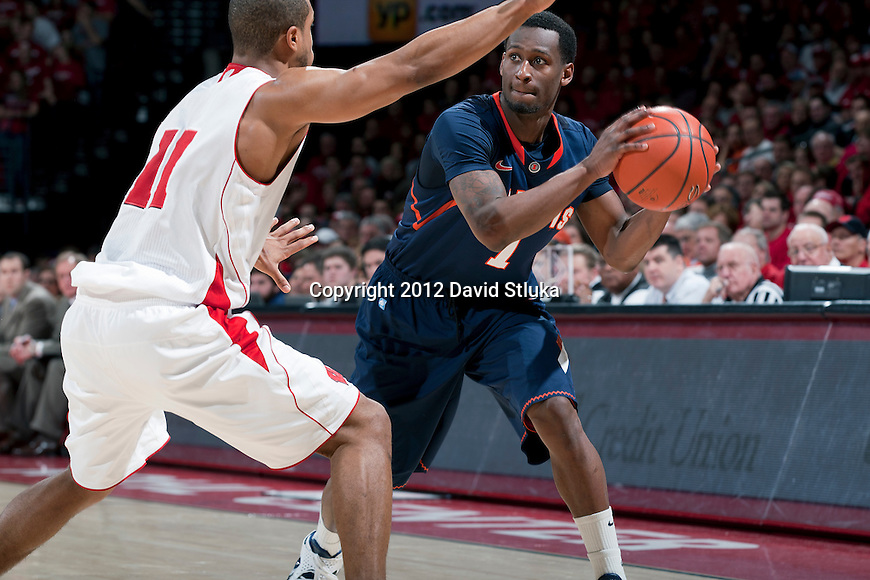 Wisconsin Badgers guard Jordan Taylor (11) defends against Illinois Fighting Illini guard D.J. Richardson (1) during a Big Ten Conference NCAA college basketball game on Sunday, March 4, 2012 in Madison, Wisconsin. The Badgers won 70-56. (Photo by David Stluka)