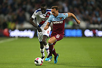 Cheikhou Kouyate of Crystal Palace and Mark Noble of West Ham United during West Ham United vs Crystal Palace, Premier League Football at The London Stadium on 5th October 2019
