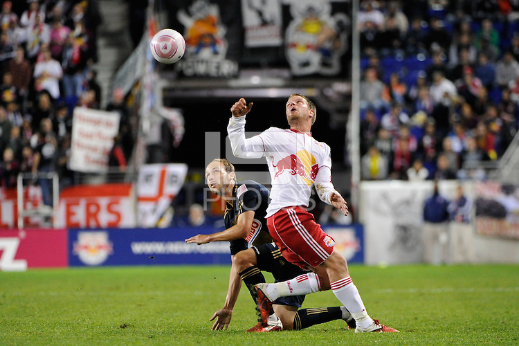 Justin Mapp (22) of the Philadelphia Union and Teemu Tainio (2) of the New York Red Bulls watch the ball. The New York Red Bulls defeated the Philadelphia Union  1-0 during a Major League Soccer (MLS) match at Red Bull Arena in Harrison, NJ, on October 20, 2011.