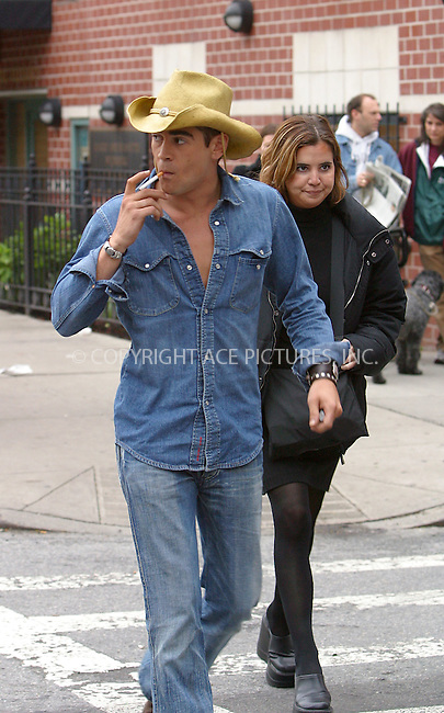 """Irish actor Colin Farrell and Robin Wright Penn are filming """"A Home at the End of the World"""" in East Village in New York. May 24, 2003. ....SHORT SYNOPSIS: The Hours author Michael Cunningham adapts his first novel A Home at the End of the World into a drama starring Colin Farrell and Robin Wright-Penn. Set in New York City, a man moves in with his best friend and falls for their female roommate, complicating his gay friend's plans to have a child with her. Broadway director Michael Mayer makes his feature debut.  ....Please byline: NY Photo Press.   ..*PAY-PER-USE*      ....NY Photo Press:  ..phone (646) 267-6913;   ..e-mail: info@nyphotopress.com"""
