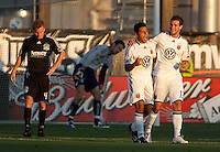 Christian Gomez (white, left) celebrates his goal with Chris Pontius (13) ahead of Chris Leitch (4) and Joe Cannon (back). The San Jose Earthquakes tied DC United 2-2 at Buck Shaw Stadium in Santa Clara, California on July 25, 2009.