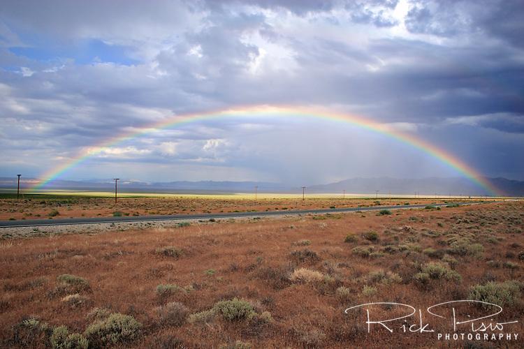 A rainbow arches across the Great Basin desert near Baker, Nevada.