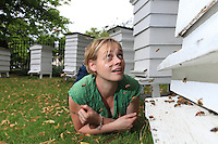 Camilla Goddart, 38years old, posing with her hives at the University of Greenwich near the tombs of famous admirals such as Nelson. For Camilla, Capital Bee is an enterprise that seeks to carry out ethical business while keeping in mind that it was founded in response to the disappearance of bees in England. Camilla also assists, through advice, young beekeepers just starting out in order to help protect the species.