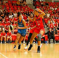 29th December 2019; Bendat Basketball Centre, Perth, Western Australia, Australia; Womens National Basketball League Australia, Perth Lynx versus Canberra Capitals; Kia Nurse of the Canberra Capitals drives forward  against Imani McGee-Stafford of the Perth Lynx - Editorial Use