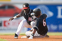 Eduardo Escobar (6) of the Kannapolis Intimidators is tagged out at second base by Silvio Pena (13) of the Hickory Crawdads as he tried to stretch a single into a double at L.P. Frans Stadium in Hickory, NC, Sunday, August 17, 2008.