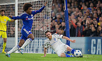 Goal scorer Willian of Chelsea goes forward but is stopped by Vitorino Antunes of Dynamo Kiev (Dynamo Kyiv) during the UEFA Champions League Group G match between Chelsea and Dynamo Kyiv at Stamford Bridge, London, England on 4 November 2015. Photo by Andy Rowland.