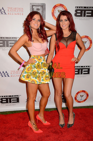 Carla Howe, Melissa Howe<br /> 8th Annual BTE All-Star Celebrity Kick-Off Party at Playboy Mansion in Los Angeles, CA., USA.<br /> July 15th, 2013<br /> full length red pink black sheer yellow skirt cleavage dress hand on hip pink<br /> CAP/ADM/BT<br /> &copy;Birdie Thompson/AdMedia/Capital Pictures