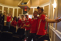 Denver, CO - Wednesday, June 18, 2014:  Chile fans cheer after their team defeated Spain in a World Cup first round match in Thornton, CO.  They were among two dozen Chileans who gathered to watch the match at a private screening room in a condominium complex in suburban Denver.