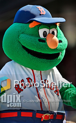 10 June 2012: Boston Red Sox Mascot Wally, the Green Monster, entertains the fans during a game against the Washington Nationals at Fenway Park in Boston, MA. The Nationals defeated the Red Sox 4-3 to sweep their 3-game interleague series. Mandatory Credit: Ed Wolfstein Photo