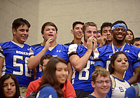 NWA Democrat-Gazette/BEN GOFF @NWABENGOFF<br /> Roger football players cheer for the homecoming court on Friday Sept. 18, 2015 during the homecoming ceremony at Rogers High School.