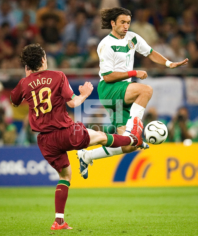Tiago (19) of Portugal in action against Jose Fonseca (17) of Mexico. Portugal defeated Mexico 2-1 in their FIFA World Cup Group D match at FIFA World Cup Stadium, Gelsenkirchen, Germany, June 21, 2006.