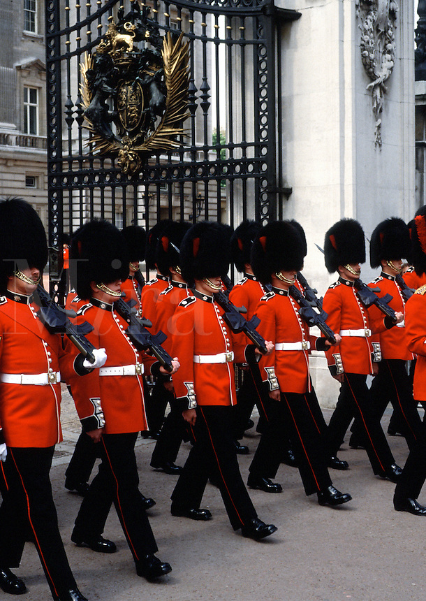 Soldiers march in formation during the traditional Changing of the Guard at Buckingham Palace. London, England.