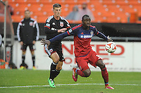 Washington, D.C.- March 29, 2014. Jhon Kennedy Hurtado of the Chicago Fire shield the ball against Conor Doyle (30) of D.C. United.  The Chicago Fire tied D.C. United 2-2 during a Major League Soccer Match for the 2014 season at RFK Stadium.