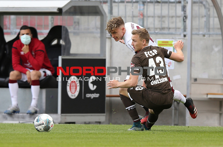 nph00001  17.05.2020 --- Fussball --- Saison 2019 2020 --- 2. Fussball - Bundesliga --- 26. Spieltag: FC Sankt Pauli - 1. FC Nürnberg ---  DFL regulations prohibit any use of photographs as image sequences and/or quasi-video - Only for editorial use ! --- <br /> <br /> Robin Hack (17, 1. FC Nürnberg ) Sebastian Ohlsson (43, FC St. Pauli ) <br /> <br /> Foto: Daniel Marr/Zink/Pool//via Kokenge/nordphoto