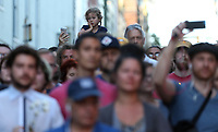 A child watches from her parents shoulder during a large vigil for Heather Heyer Sunday night at 4th Street SE and Water Street in Charlottesville, Va. Heyer was killed and 19 others injured when a car intentionally ran through a crowd of counter protestors after the Unite The Right rally. Photo/Andrew Shurtleff/The Daily Progress