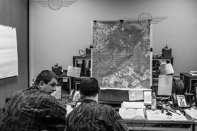 Officers in the situation room during NATO Iron Sword joint exercises.