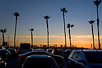 Parking lot and people watching the sunset at Venice Beach, CA