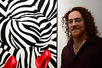 "MIAMI, FL - DECEMBER 05: Artist Blake Emory poses for a portrait during his debuts of provoking abstract collection of works ""Zebra Love"" at this year's Spectrum Miami exhibit during Art Basel Miami Beach on Friday December 5, 2014 in Miami, Florida. (Photo by Johnny Louis/jlnphotography.com)"