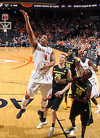 Dec. 17, 2010; Charlottesville, VA, USA; Virginia Cavaliers guard Jontel Evans (1) shoots the ball in front of Oregon Ducks forward E.J. Singler (25) and Oregon Ducks guard Jay-R Strowbridge (55) during the first half of the game at the John Paul Jones Arena. Mandatory Credit: Andrew Shurtleff-