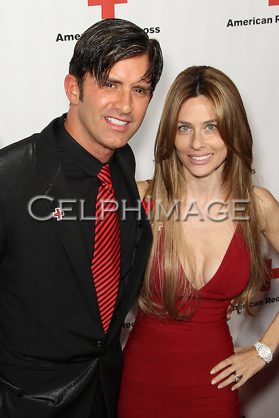"DR ROBERT REY, HAYLEY REY. Red carpet arrivals to the annual ""Red Tie Affair,"" benefitting the American Red Cross of Santa Monica, and honoring the humanitarian spirit of those who have shown courage, unselfish character and whose work has saved lives. At the Fairmont Miramar. Santa Monica, CA, USA. April 17, 2010."