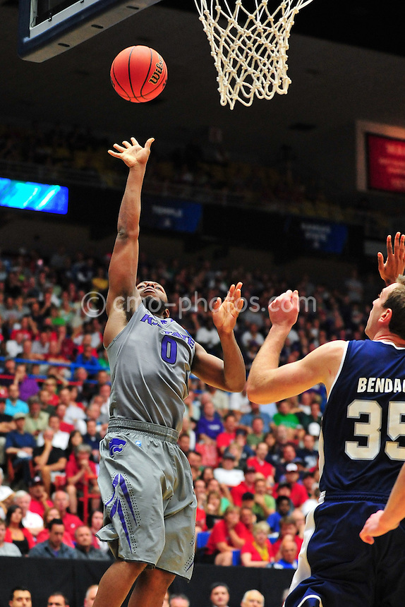 Mar 17, 2011; Tucson, AZ, USA; Kansas State Wildcats guard Jacob Pullen (0) shoots the ball in the first half of a game against the Utah State Aggies in the second round of the 2011 NCAA men's basketball tournament at the McKale Center.