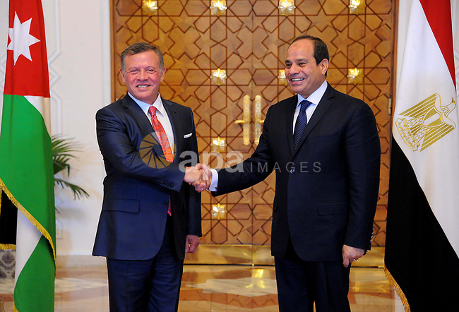 Egyptian President Abdel Fattah al-Sisi shakes hands with Jordan's King Abdullah II before a meeting in the Egyptian capital Cairo, on May 17, 2017. Photo by Egyptian President Office
