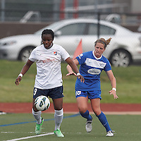 Sky Blue FC forward Danesha Adams (9) controls the ball as Boston Breakers defender Maddy Evans (18) closes. In a National Women's Soccer League Elite (NWSL) match, Sky Blue FC (white) defeated the Boston Breakers (blue), 3-2, at Dilboy Stadium on June 16, 2013.