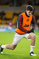 4th January 2020; Molineux Stadium, Wolverhampton, West Midlands, England; English FA Cup Football, Wolverhampton Wanderers versus Manchester United; Harry Maguire of Manchester United stretching before the match  - Strictly Editorial Use Only. No use with unauthorized audio, video, data, fixture lists, club/league logos or 'live' services. Online in-match use limited to 120 images, no video emulation. No use in betting, games or single club/league/player publications